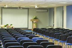 Interior of Empty Conference Hall With Lines of Blue Chairs in F Stock Photos