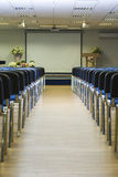 Interior of Empty Conference Hall With Lines of Blue Chairs in F Stock Photo