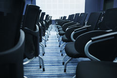 Interior of empty conference hall. With Plastic chairs , close-up Royalty Free Stock Photo