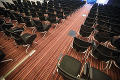 Interior of empty conference hall. With Plastic chairs , close-up Stock Photos