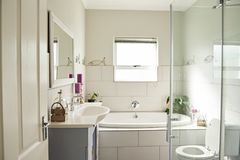 Interior of the modern bathroom in a contemporary suburban home Royalty Free Stock Images