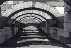 Interior of empty corridor with arcs. Ancient Smyrna. Izmir Stock Image