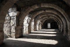 Interior of empty dark corridor with arcs. Ruins of Ancient city Smyrna. Izmir, Turkey Stock Images