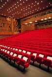 Interior of empty hall with red arm-chairs Royalty Free Stock Images