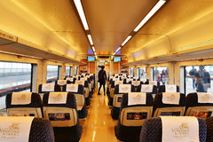 Interior of empty high speed railway carriage  stops at a station. In China ,Asia.The rows of seats,lit up by led lights Royalty Free Stock Images