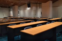 Interior of empty modern conference hall with chairs tables and completely facilities Royalty Free Stock Image