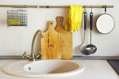 Interior of empty modern white kitchen with various objects stock image