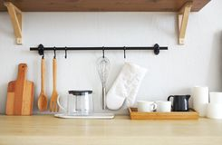 Interior of empty modern white kitchen with various objects royalty free stock photos