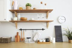 Interior of empty modern white kitchen with various objects royalty free stock photography