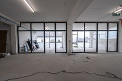 Interior empty office light room in a new building renovation or under construction. Glass doors and Windows.  royalty free stock photos