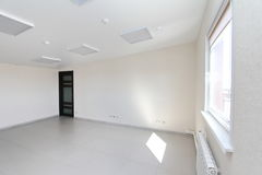 Interior empty office light room with white wallpaper unfurnished in a new building Stock Photography