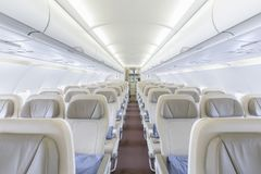 Interior of empty ready to fly airliner cabin with rows of seats.  Stock Photography