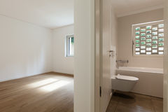 Interior, empty room with bathroom. Interior of new apartment, empty room with bathroom, parquet floor Royalty Free Stock Photography