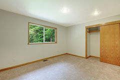 Interior of empty room with closet, carpet floor and small window. Stock Photo