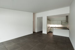 Interior, empty room with domestic kitchen Royalty Free Stock Image