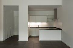 Interior, empty room with domestic kitchen Stock Photo