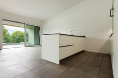 Interior, empty room with domestic kitchen Stock Photography