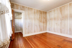 Interior of empty room in old house. With small closet and light tones paneled wall trim. Northwest, USA stock image