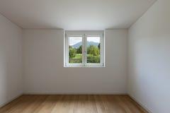 Interior, empty room with window Stock Images