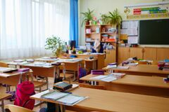 Interior of an empty school classroom. Concept of coronavirus COVID-19 quarantine in schools and educational institutions