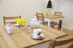 Interior Of Empty Tea Shop With Tables And Crockery Stock Image