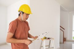 Interior engineer with new house blueprint Stock Images