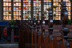 The interior of an English chapel. With focus on stained glass stock image