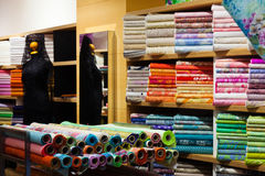 Interior of fabric shop. Textiles for sale in interior of fabric shop Stock Photos
