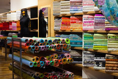 Interior of fabric shop. Various textiles for sale in interior of fabric shop Royalty Free Stock Photo