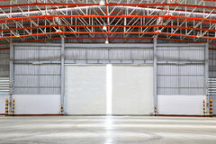 Interior of factory with shutter door Stock Photos