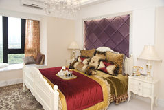 Interior of a fashion bedroom. With a luxury bed Royalty Free Stock Image