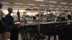 Interior of fashionable shop with different clothes stock footage