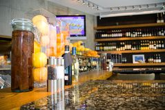 Interior of fine restaurant. A view of the interior of a fine fish and wine restaurant with shiny marble table and seasonings on one side, and a large wine rack Royalty Free Stock Images
