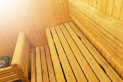 Interior of Finnish sauna, classic wooden sauna, Finnish bathroom. Wooden sauna cabin. Wooden room. Sauna steam. Soft lighting. Interior of Finnish sauna stock photos