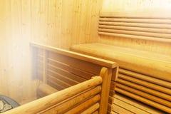 Interior of Finnish sauna, classic wooden sauna, Finnish bathroom. Wooden sauna cabin. Wooden room. Sauna steam. Soft lighting. Interior of Finnish sauna royalty free stock images