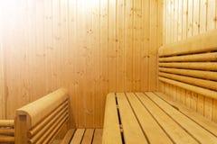 Interior of Finnish sauna, classic wooden sauna, Finnish bathroom. Wooden sauna cabin. Wooden room. Sauna steam. Soft lighting.  royalty free stock image
