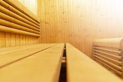 Interior of Finnish sauna, classic wooden sauna, Finnish bathroom. Wooden sauna cabin. Wooden room. Sauna steam. Soft lighting.  stock photo