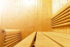 Interior of Finnish sauna, classic wooden sauna, Finnish bathroom. Wooden sauna cabin. Wooden room. Sauna steam. Soft lighting. Interior of Finnish sauna stock photo