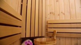 Interior of finnish sauna and sauna accessories stock video footage