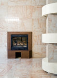 Interior with fireplace Stock Photos