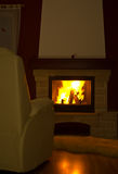 Interior Fireplace Burning. An interior fireplace setting looking cozy and warm in the evening Royalty Free Stock Image
