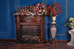 Interior with fireplace and flowers Royalty Free Stock Photography