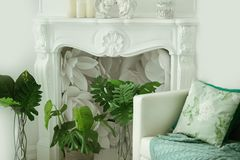 Interior fireplace tropical cushions Chair royalty free stock photography