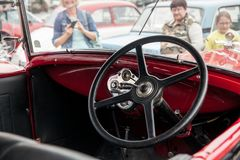 Interior Ford, inside view, retro design car. Exhibition of vintage cars. Rally of old vintage vehicles anciens. Collectors unique cars. Dark red with round Stock Images