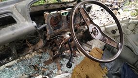 Interior of forgotton broken car Stock Photography