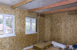 Interior of frame house under construction. Made of OSB stock photo