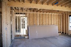 Interior Frame of a Suburban Home Under Construction. Interior of a Suburban Home being prepped for dry wall installation stock images