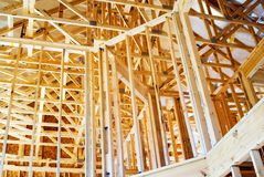 Interior Framing/New Home. New construction showing the interior rafters and framing Royalty Free Stock Photo