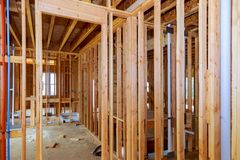 Interior framing of a new house under construction. Construction home framing royalty free stock photography