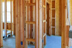 Interior framing of a new house under construction. Construction home framing stock photos